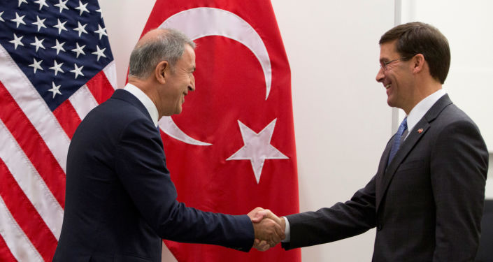 Turkish Defense Minister Hulusi Akar and acting U.S. Secretary for Defense Mark Esper shake hands during a NATO Defence Ministers meeting in Brussels, Belgium June 26, 2019. Virginia Mayo/Pool via REUTERS