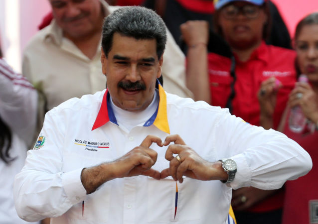 FILE PHOTO: Venezuela's President Nicolas Maduro gestures during a rally in support of the government in Caracas, Venezuela May 20, 2019. REUTERS/Ivan Alvarado/File Photo