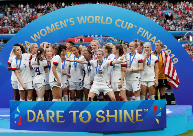Soccer Football - Women's World Cup Final - United States v Netherlands - Groupama Stadium, Lyon, France - July 7, 2019  Megan Rapinoe of the U.S. and team mates celebrate winning the women's world cup     REUTERS/Bernadett Szabo