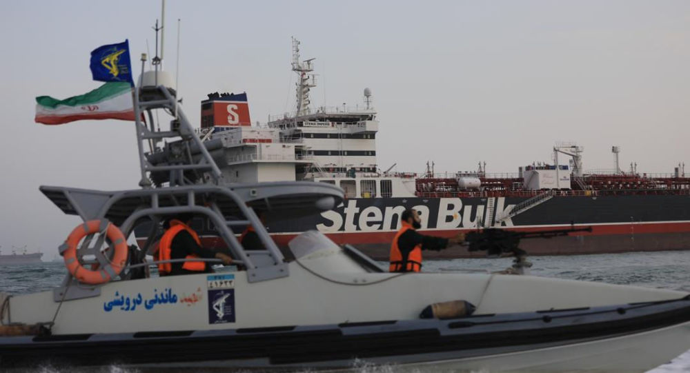 A boat of Iranian Revolutionary Guard sails next to Stena Impero, a British-flagged vessel owned by Stena Bulk, at Bandar Abbas port, in this undated handout photo. Iran, ISNA/WANA Handout via REUTERS ATTENTION EDITORS - THIS IMAGE WAS PROVIDED BY A THIRD PARTY.