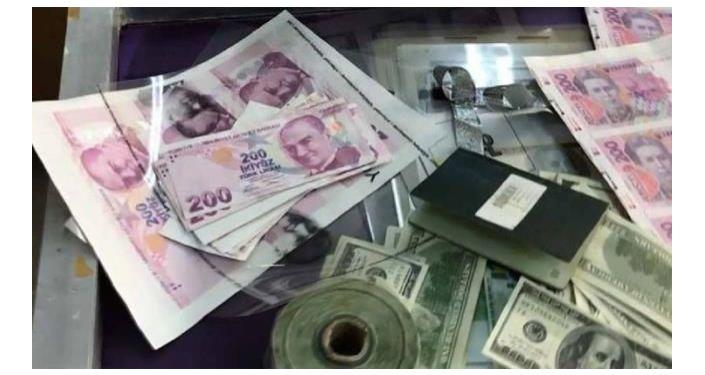 Denizli'de 2 dolandırıcı sahte paraları mum kullanarak orijinaline yakın hale getirdi