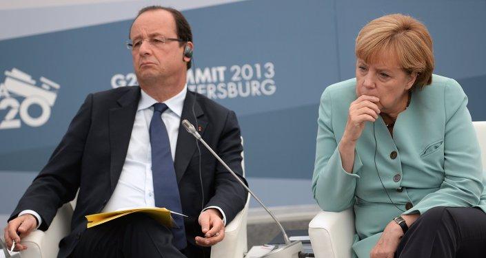 Almanya Başbakanı Angela Merkel ve Fransa Cumhurbaşkanı François Hollande
