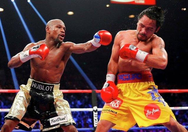 Boksörler Floyd Mayweather ile Manny Pacquiao