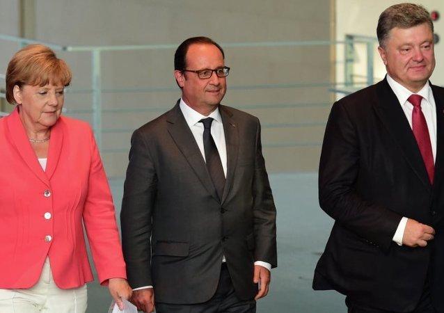 Almanya Başbakanı Angela Merkel, Fransa Cumhurbaşkanı Francois Hollande, Ukrayna Devlet Başkanı Pyotr Poroşenko
