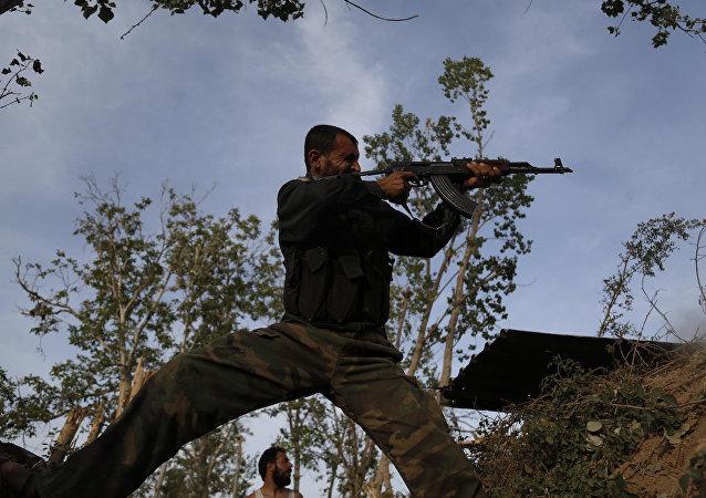 Şam'daki bir Feylak-ül Rahman militanı.