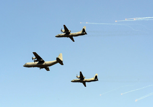 Indian Air Force C-130 Hercules (C) and two AN-32 aircrafts