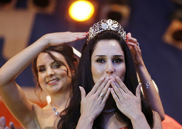 Suriyeli sığınmacı Ninorta Bahno, Almanya'da 'şarap kraliçesi' seçildi.