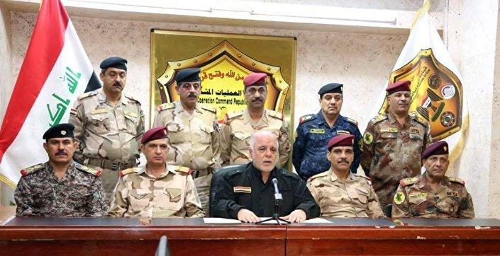 İbadi, Genelkurmay Başkanı Osman Ganimi başta olmak üzere 9 üst rütbeli subayla birlikte açıklama yaptı.