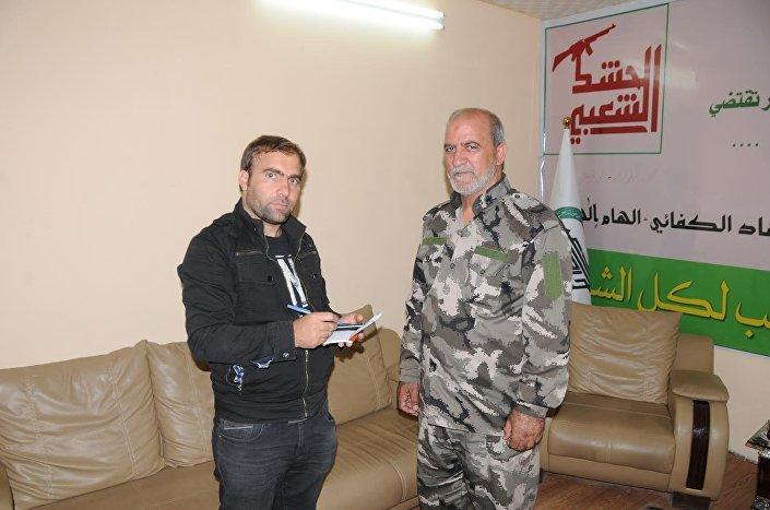 Haşdi Şabi komutanı Abdulselam Muhammed ve Sputnik muhabiri Hikmet Durgun