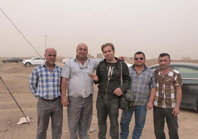 Musul'daki hristiyanların önde gelenlerinden Baha Erzan Asu ve Sputnik muhabiri Hikmet Durgun