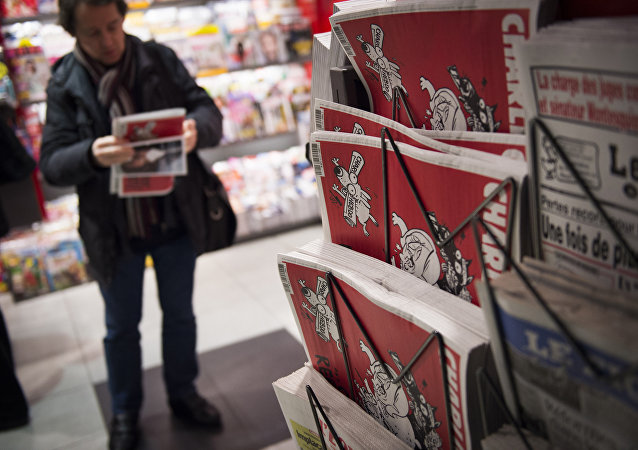 A man holds the latest edition of French satirical weekly newspaper Charlie Hebdo at a train station in Paris on February 25, 2015