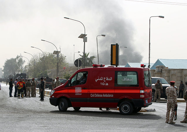 An ambulance arrives at the scene of a bomb attack in Baghdad. File photo