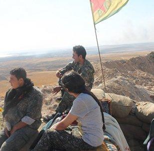 Rakka'nın IŞİD'in elinden alınması için savaşan DSG'ye bağlı YPG savaşçıları