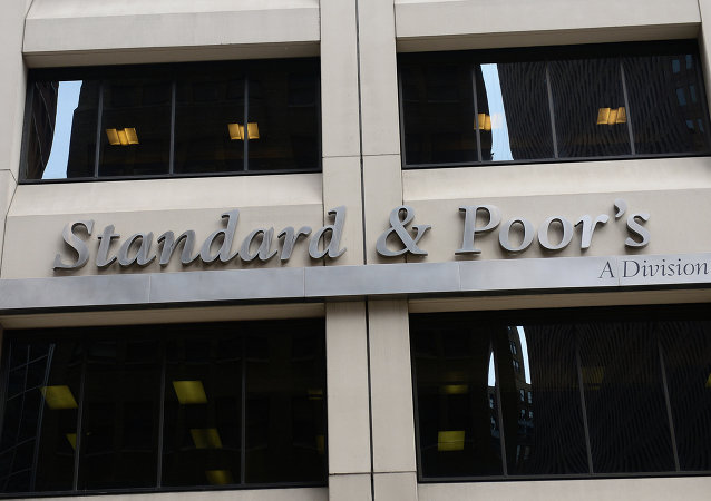 A sign for Standard & Poor's rating agency stands in front of the company headquarters in New York