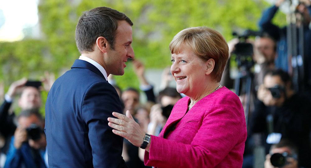 Fransa Cumhurbaşkanı Emmanuel Macron ve Almanya BaşbakanI Angela Merkel
