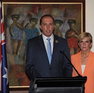 Australian Immigration Minister Peter Dutton (L)