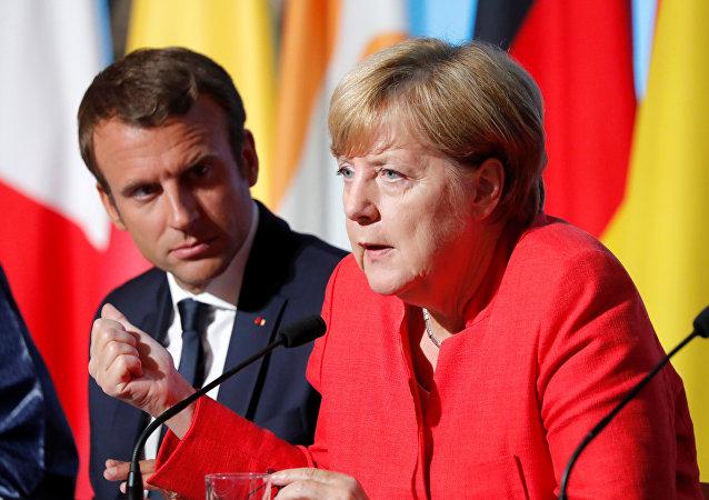 Fransa Cumhurbaşkanı Emmanuel Macron ve Almanya Başbakanı Angela Merkel