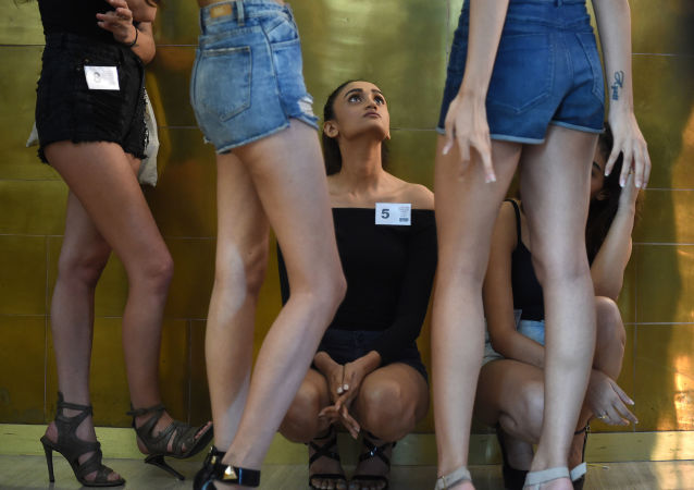 Models wait to appear before the judges during the Lakme Fashion Week (LFW) model auditions in Mumbai