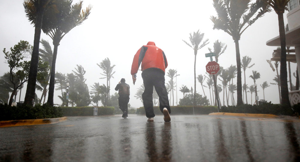 People walk along a street in South Beach as Hurricane Irma arrives at south Florida, in Miami Beach, Florida, U.S., September 10, 2017