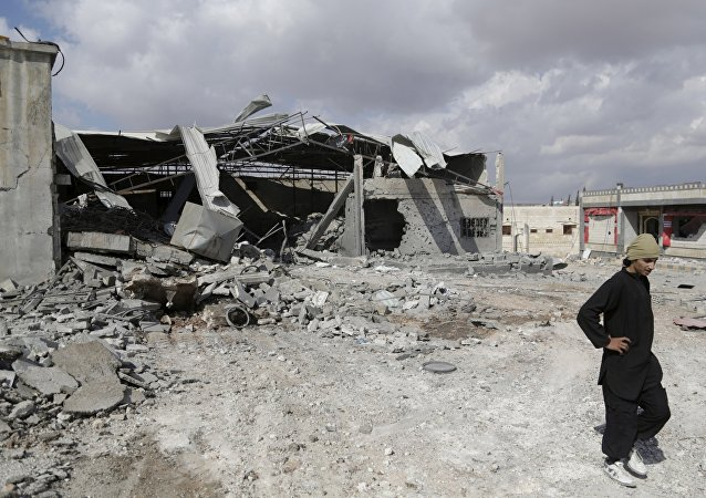 A man inspects a site hit by what activists said were airstrikes carried out by the Russian air force in the town of Babila, in the southern countryside of Idlib, Syria, October 7, 2015
