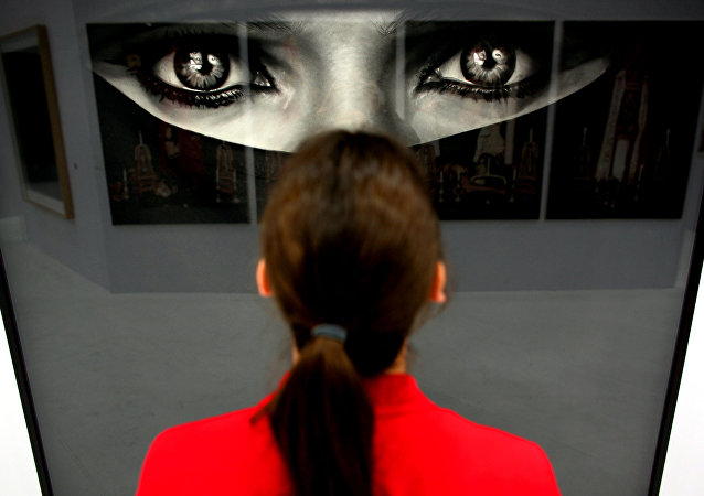 A woman looks at the work Burka by US artist Robert Longo at the booth of the gallery Hans Mayer on April 12, 2011 at the Art Cologne art fair in Cologne, western Germany. Around 200 international galleries will be showcasing Classic Modernism, Post-War and Contemporary art during the fair running until April 17, 2011.
