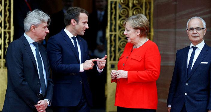 Fransa Cumhurbaşkanı Emmanuel Macron ile Almanya Başbakanı Angela Merkel