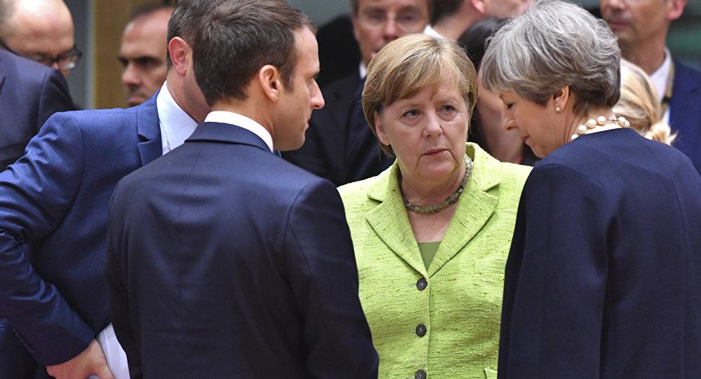 Fransa Cumhurbaşkanı Emmanuel Macron, Almanya Başbakanı Angela Merkel, İngiltere Başbakanı Theresa May