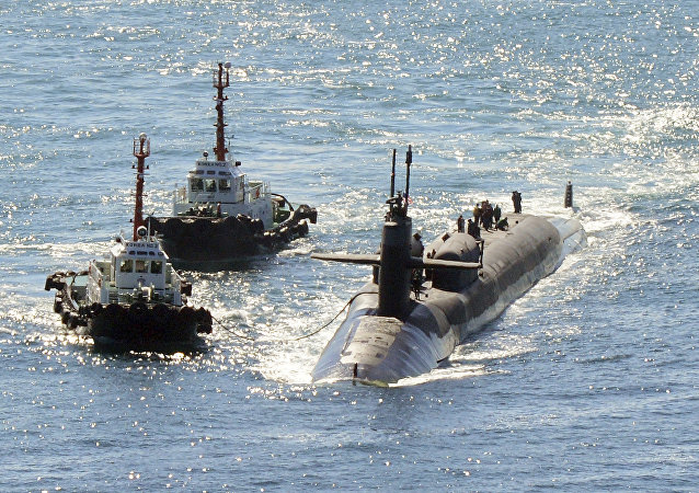 The nuclear-powered submarine USS Michigan approaches a naval base in Busan, South Korea, amid North Korea's nuclear and missile provocations