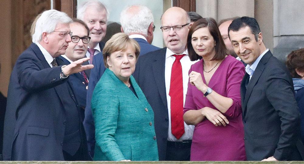 Almanya Başbakanı Angela Merkel ile Yeşiller Partisi Eş Başkanı Cem Özdemir
