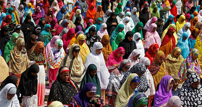 Women offer prayers at the Qutub-e-Alam shrine on the eve of the Eid al-Adha festival on the outskirts of Ahmedabad, India, September 12, 2016.
