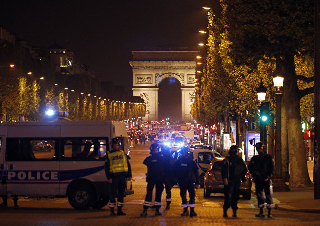 Police seal off the Champs Elysees avenue in Paris, France, after a fatal shooting in which a police officer was killed along with an attacker, Thursday, April 20, 2017.