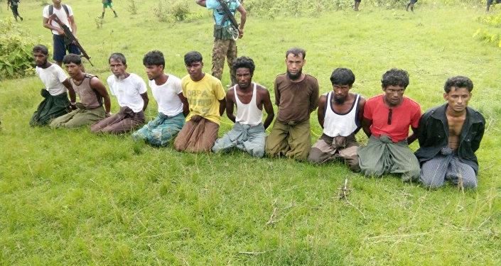 Myanmar Arakan eylaeti Inn Din köyü Müslüman katliamı Reuters araştırmacı gazetecilik
