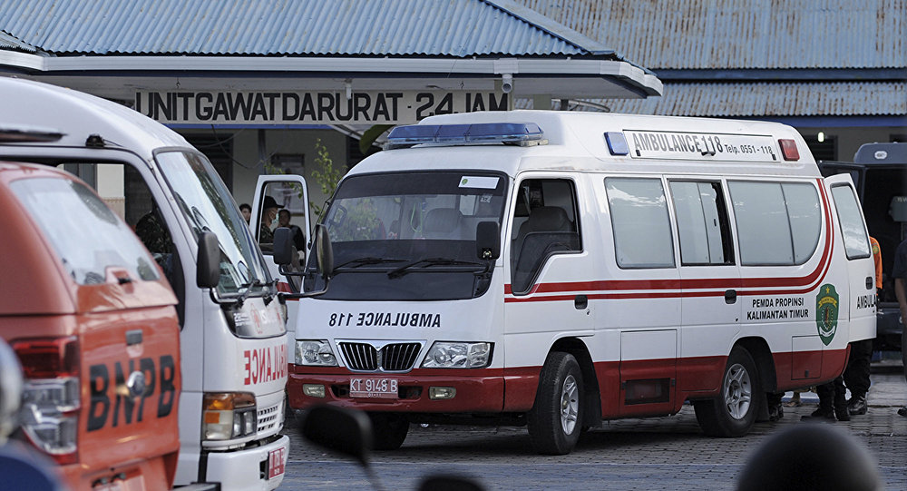 Ambulances carrying the survivors of an army helicopter that crashed during a mission to build a border post on Borneo island are parked at a military hospital in Tarakan, Indonesia, Saturday, Nov. 9, 2013.