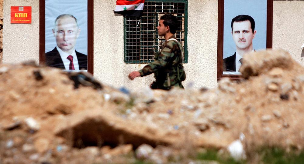 Doğu Guta'da Putin ve Esad posterleri