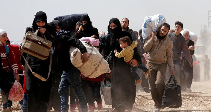 Hammuriye'den tahliye edilen Suriyeliler