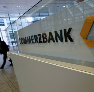 A man walks past a logo of Commerzbank ahead of the bank's annual news conference in Frankfurt February 12, 2015