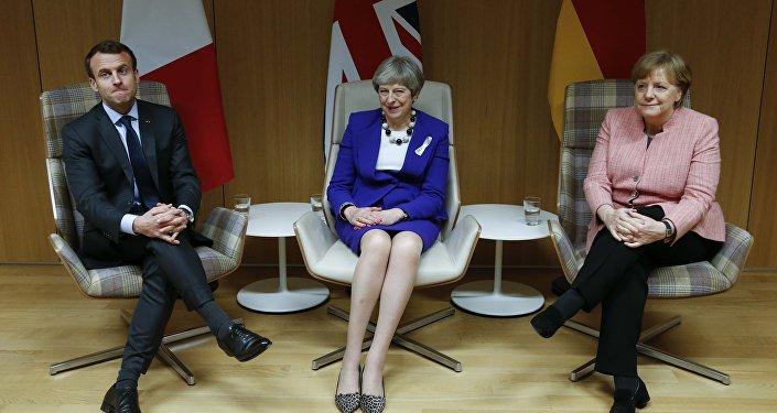 Fransa Cumhurbaşkanı Emanuel Macron, İngiltere Başbakanı Theresa May ve Almanya Başbakanı Angela Merkel