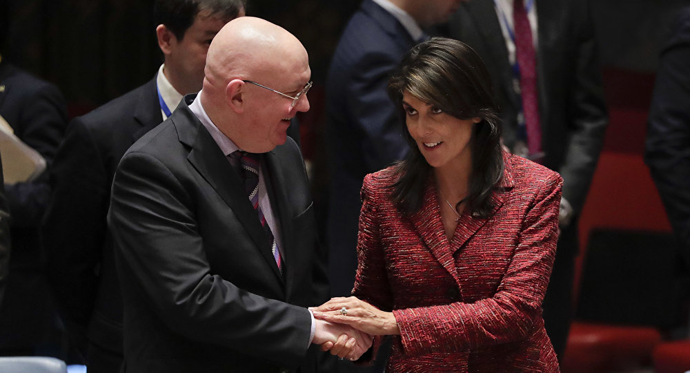 Russian Ambassador to the United Nations Vasily Nebenzya, left, and United States Ambassador to the U.N. Nikki Haley shake hands before a Security Council meeting, Tuesday, April 10, 2018, at U.N. headquarters