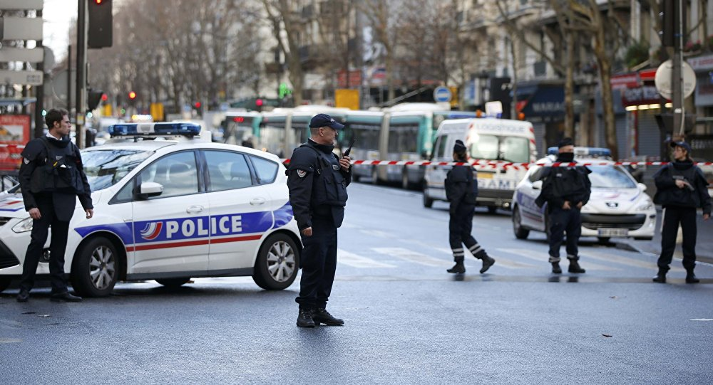 French police secure the area after a man was shot dead at a police station in the 18th district in Paris, France January 7, 2016