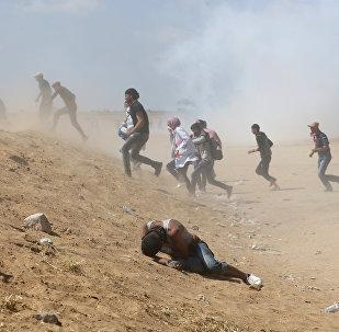 15 Mayıs'taki Nakba Günü'nde İsrail-gazze sınırındaki Filistinli eylemciler