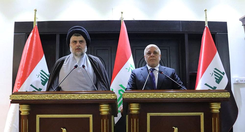 Irak'ta seçimin galibi olan Şii lider Mukteda es Sadr ve Başbakan Haydar el İbadi