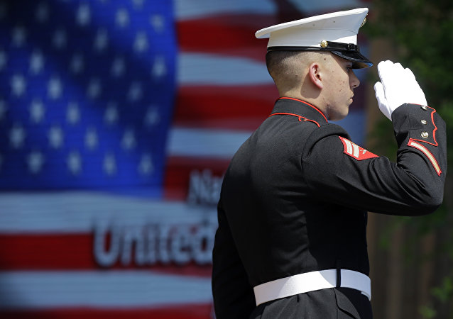 An officer of the US Marine Corps Color Guard stands at attention during the flag raising ceremony at the official opening of the National Day USA, at the Expo 2015 world's fair in Rho, near Milan, Italy, Saturday, July 4, 2015.
