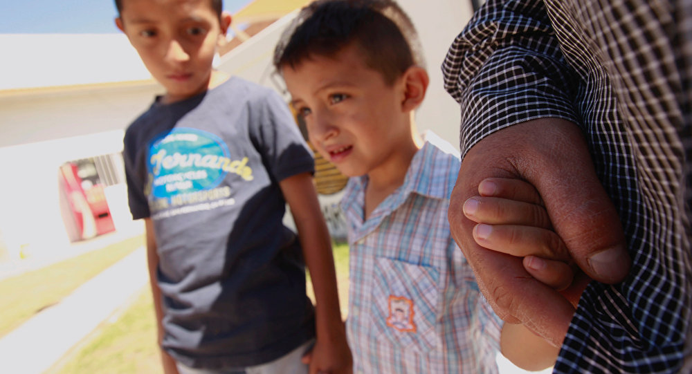 ABD'deki göçmen çocukları ayırma politikası nedeniyle Meksika'daki sığınmacı kampında kalan El Salvadorlu göçmen ve çocukları