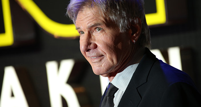 Harrison Ford poses for photographers upon arrival at the European premiere of the film 'Star Wars: The Force Awakens ' in London.