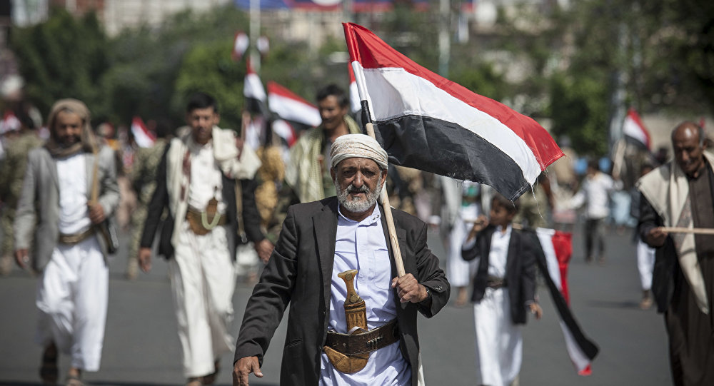 Man holds Yemen's flag during a ceremony to commemorate the 26th anniversary of Yemen's reunification, in Sanaa, Yemen (File)