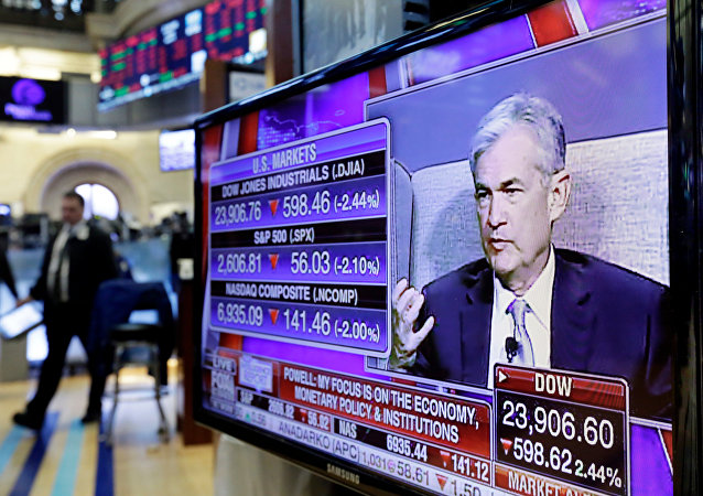 Federal Reserve Chairman Jerome Powell's speech at The Economic Club of Chicago, appears on a screen on the floor of the New York Stock Exchange, Friday, April 6, 2018