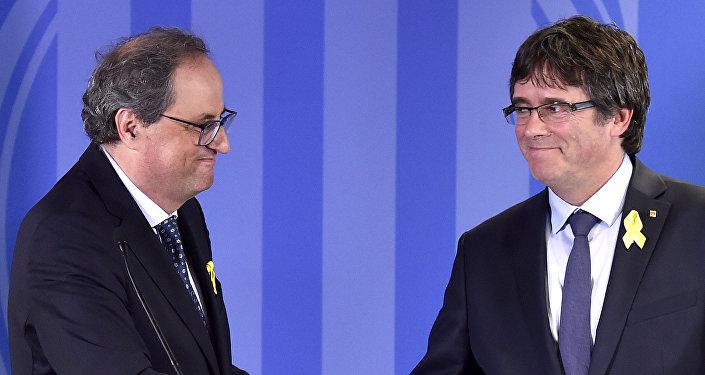 Eski Katalonya Başkanı Carles Puigdemont ve Katalonya Başkanı Quim Torra