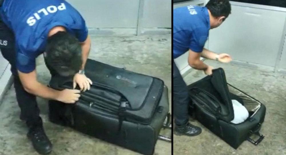 Türkiye'ye giriş yasağını, valizin içine girerek çiğnemek istedi