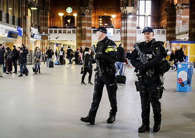 Dutch officers carry out extra patrols at the Central Station in Amsterdam, The Netherlands, 22 March 2016