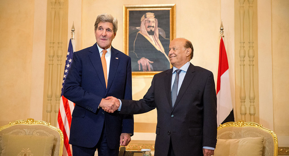 Former US Secretary of State John Kerry, left, shakes hands with President of Yemen Abd Rabbo Mansour Hadi, for photographs, at the Al-Nasarieh Guest Palace in Riyadh, Saudi Arabia